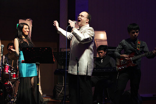 JP Montilla sings with the Industry Band