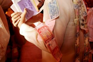 Wishing the newlyweds good fortune with the wedding money dance