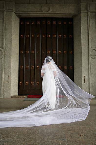 Bride at entrance of church